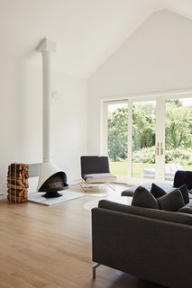 In the living room, a Malm stove faces a Como sectional from Design Within Reach.