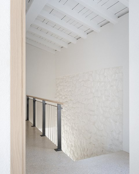 Subtly textured plaster walls meet hand-cut stone, creating a natural and organic feel.