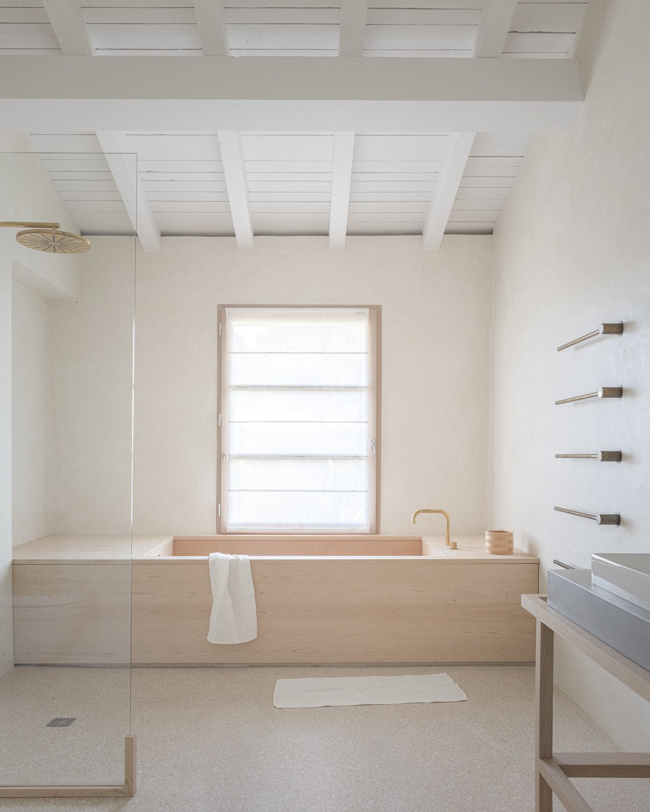Bath, Vessel, Open, and Alcove VOLA towel-warming rails climb the wall next to a custom-designed soaking tub crafted in Japan out of hinoki wood, or Japanese cypress.  Bath Open Alcove Photos from An Architect Turns a Weathered French Farmhouse Into a Monastic Retreat for His Parents