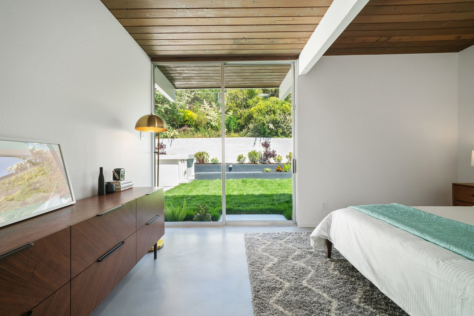 A peek into one of the four bedrooms featuring direct outdoor access.  Photo 16 of 22 in Before & After: Another A. Quincy Jones Eichler Is Returned to its Former Glory in Oakland