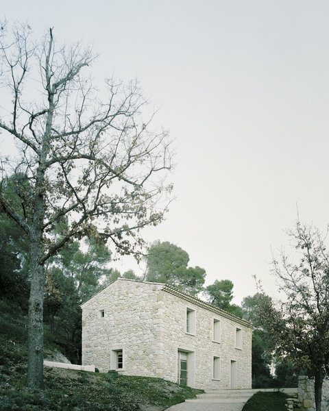 Architect Timothee Mercier of Studio XM converted a crumbling farmhouse into a residence for his parents.