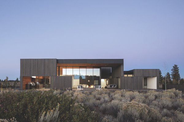 The AIA award-winning High Desert Residence by Hacker Architects recedes into its moody surroundings just outside of Bend, Oregon. Western Red Cedar, a regional material found only in the Pacific Northwest of North America, is stained a warm grey along the exterior.