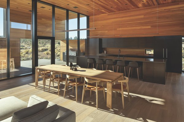 Inside, clear-coated cedar dominates the walls and ceilings, seamlessly extending along deep exterior overhangs as well. Continuously running floors and full-height windows also enhance the home's connection with the outdoors.