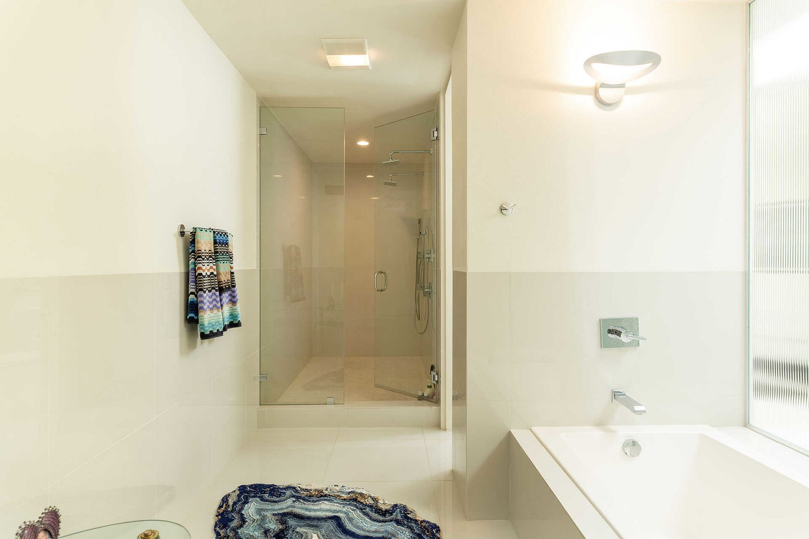 The connected bath features a large soaking tub and standalone shower.  Photo 11 of 13 in A Sassy, Pink-Trimmed Ranch Near Palm Springs Lists for $899K