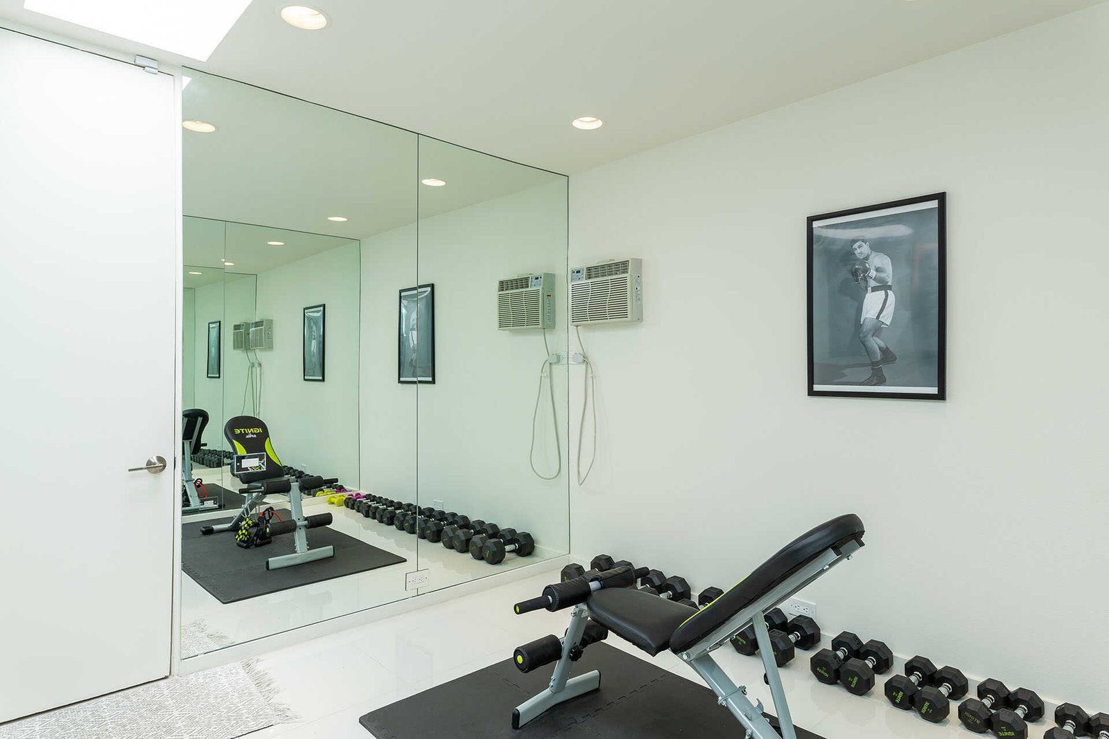 A peek at the home gym.  Photo 12 of 13 in A Sassy, Pink-Trimmed Ranch Near Palm Springs Lists for $899K