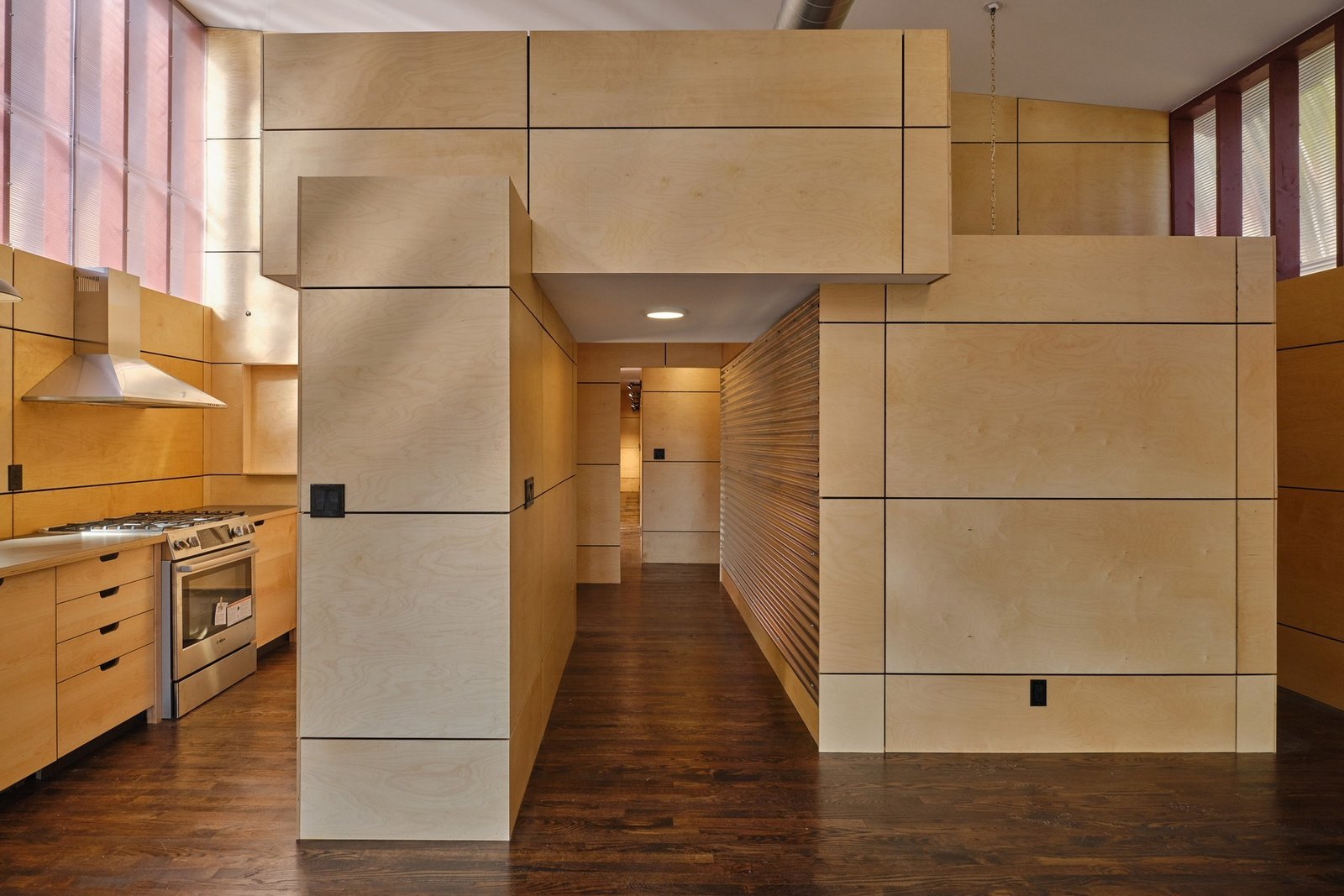 Hallway and Dark Hardwood Floor Box–like structures connect to form the hallway that leads to the bedrooms and office space.  Photo 6 of 10 in A Connecticut Condo That Hugs the Patchogue River Asks $575K
