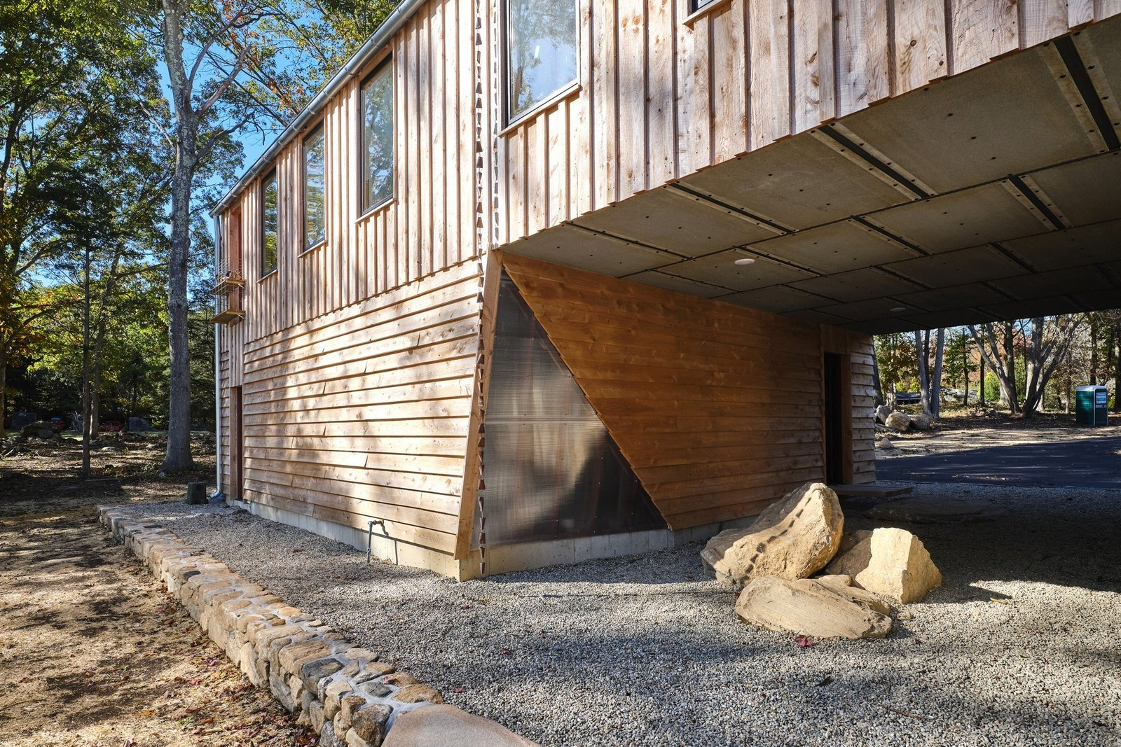 Exterior, House Building Type, Apartment Building Type, and Wood Siding Material The exterior siding of the property is built from rough-sawn Hemlock and corrugated steel.  Photo 2 of 10 in A Connecticut Condo That Hugs the Patchogue River Asks $575K