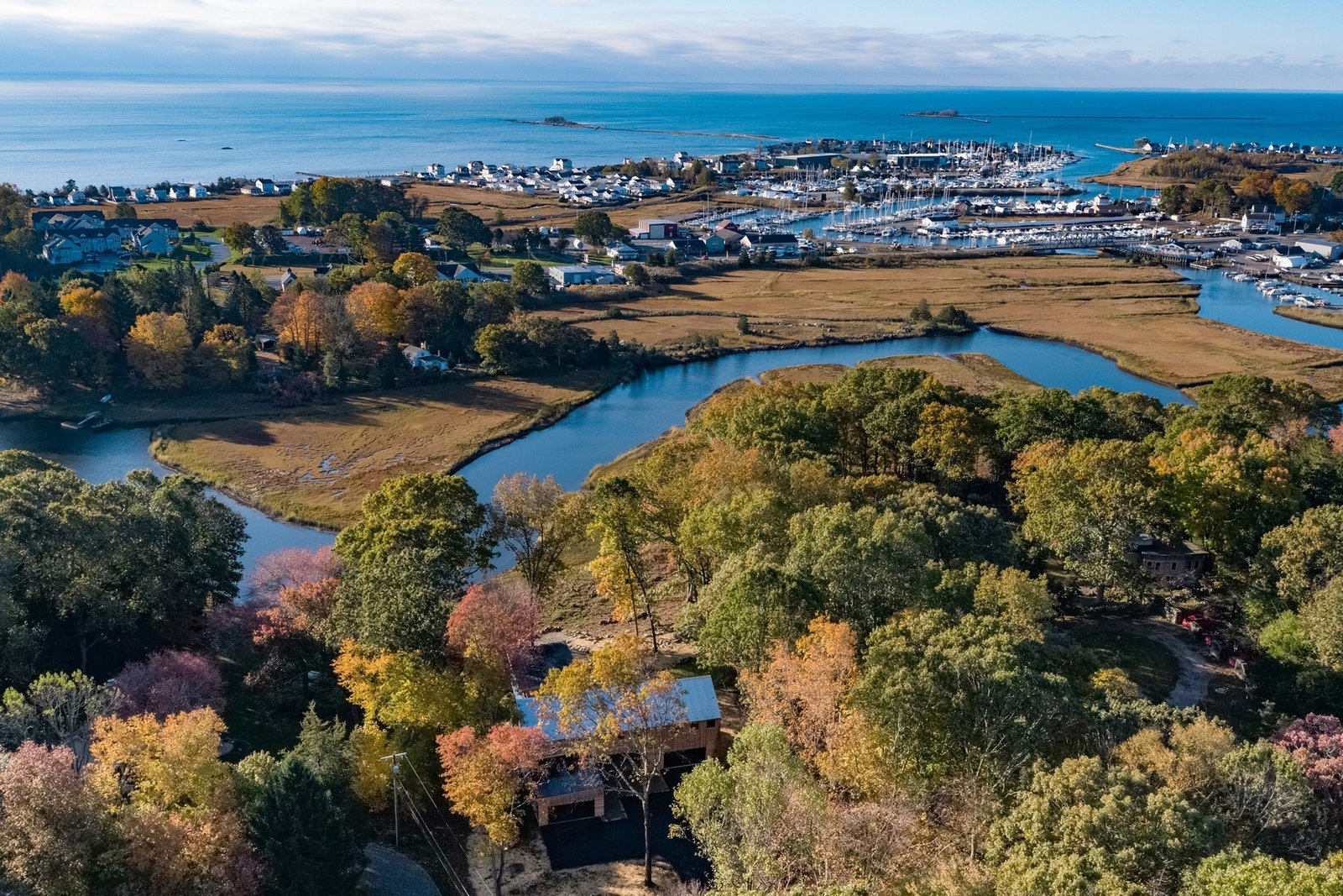 Outdoor An aerial view of the residence, which showcases the winding Patchogue River.  Photo 10 of 10 in A Connecticut Condo That Hugs the Patchogue River Asks $575K
