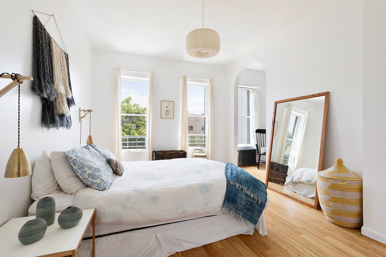 A look at one of three bedrooms located in the upper duplex.  Photo 4 of 8 in A Brooklyn Townhouse Reimagined as a Crisp, Loft-Like Duplex Asks $2.75M