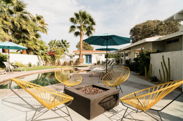 This well-appointed home boasts cheerful, design-minded interiors. The backyard provides a seemingly endless list of activities: Guests can swim in the saltwater pool, play bocce on the at-home court, or follow the sun in the several seating areas.