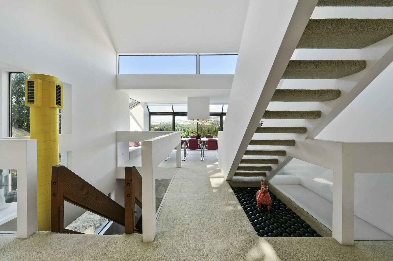 Staircase A contrasting modernist style prevails throughout the interior, accentuated by clean lines, geometric patterns, and eccentric features.  Photo 2 of 19 in With $3.3M, You Could Own Your Own Mountainside Retreat That Comes Complete With a Cable Car