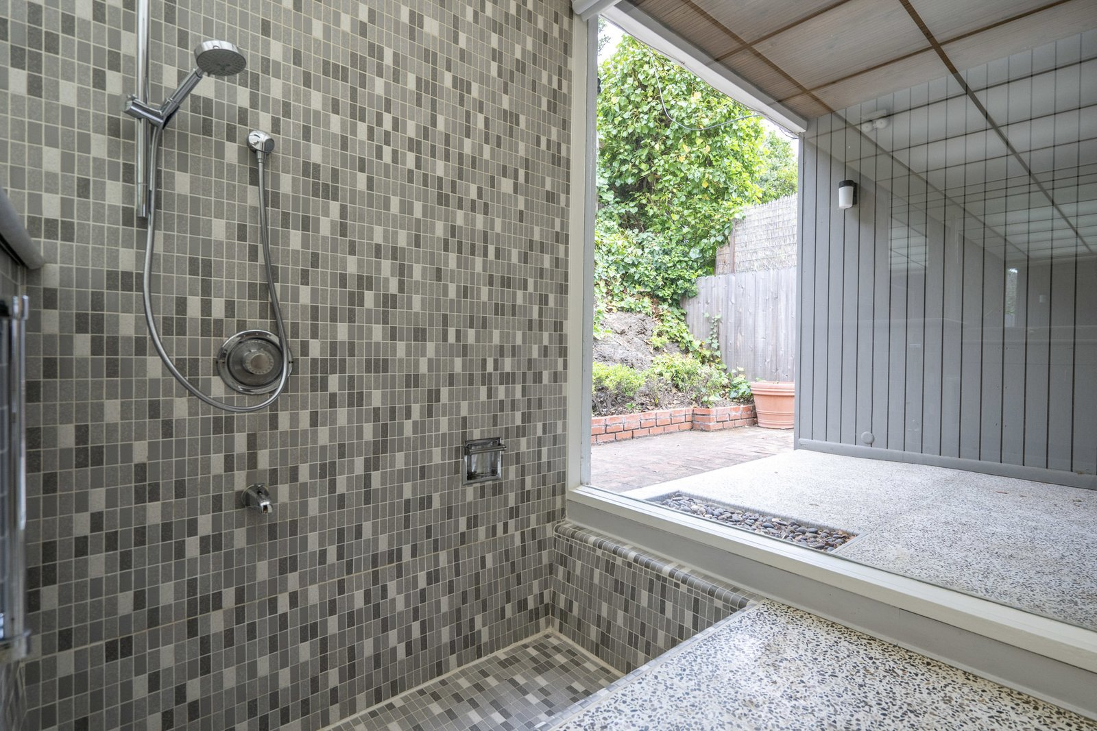Bath Room, Open Shower, Ceramic Tile Wall, and Full Shower A sunken shower area  Photo 11 of 12 in A Case Study–Style Home in San Luis Obispo Lists for $870K