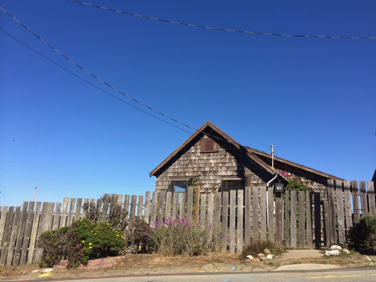 Before: The home was clad in worn-down shingles.  Photo 1 of 13 in A Weathered Beach House Becomes a Breezy, Live/Work Pad in Northern California