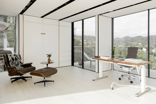 The open-layout design is completely custom. The office area looks toward downtown Los Angeles through floor-to-ceiling windows and sliders.