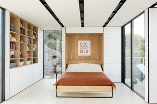 A Murphy bed folds up for additional living space, and sliders provide access to the deck.