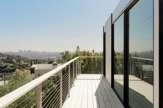 Decking extends from the living space, adding outdoor space to the Hollywood prefab.