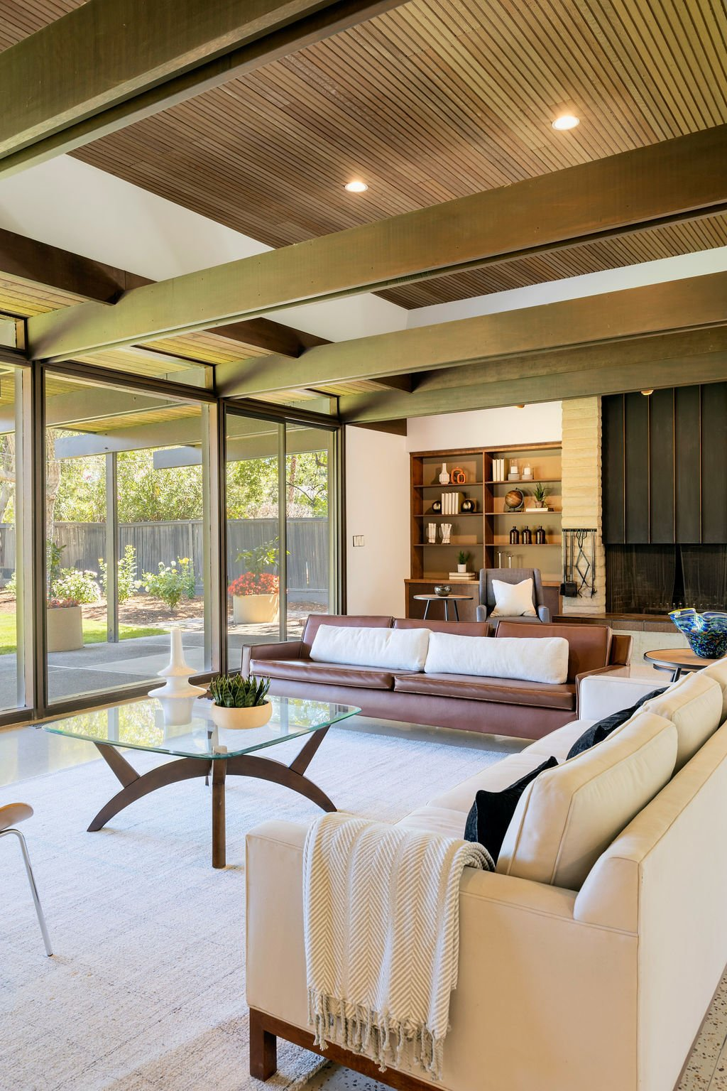 """""""The wood ceilings and beams, as well as the copper fireplace were not touched during the renovation—proof that, if you build correctly, it lasts,"""" says Marc. The beam design was made famous by A. Quincy Jones, whom Avedisian studied under at USC.   Photo 3 of 16 in A Restored Post-and-Beam by a Richard Neutra Protégé Lists for $700K"""
