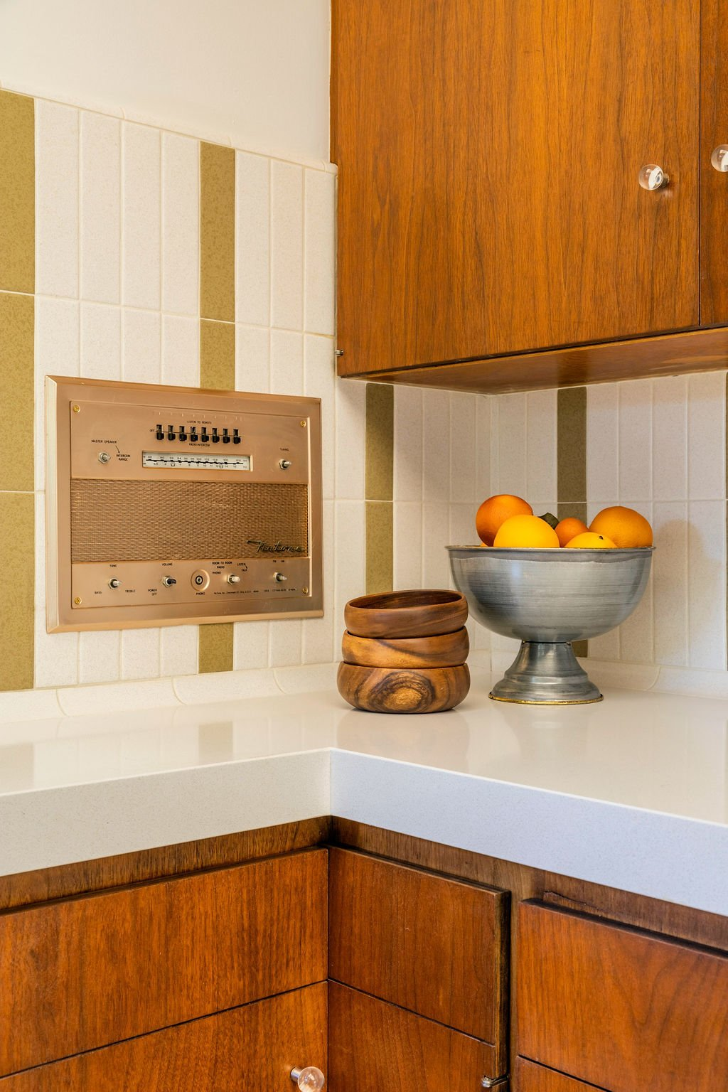Built-in Nutone appliances and backsplash tile from Heath Ceramics are more period details.  Photo 5 of 16 in A Restored Post-and-Beam by a Richard Neutra Protégé Lists for $700K