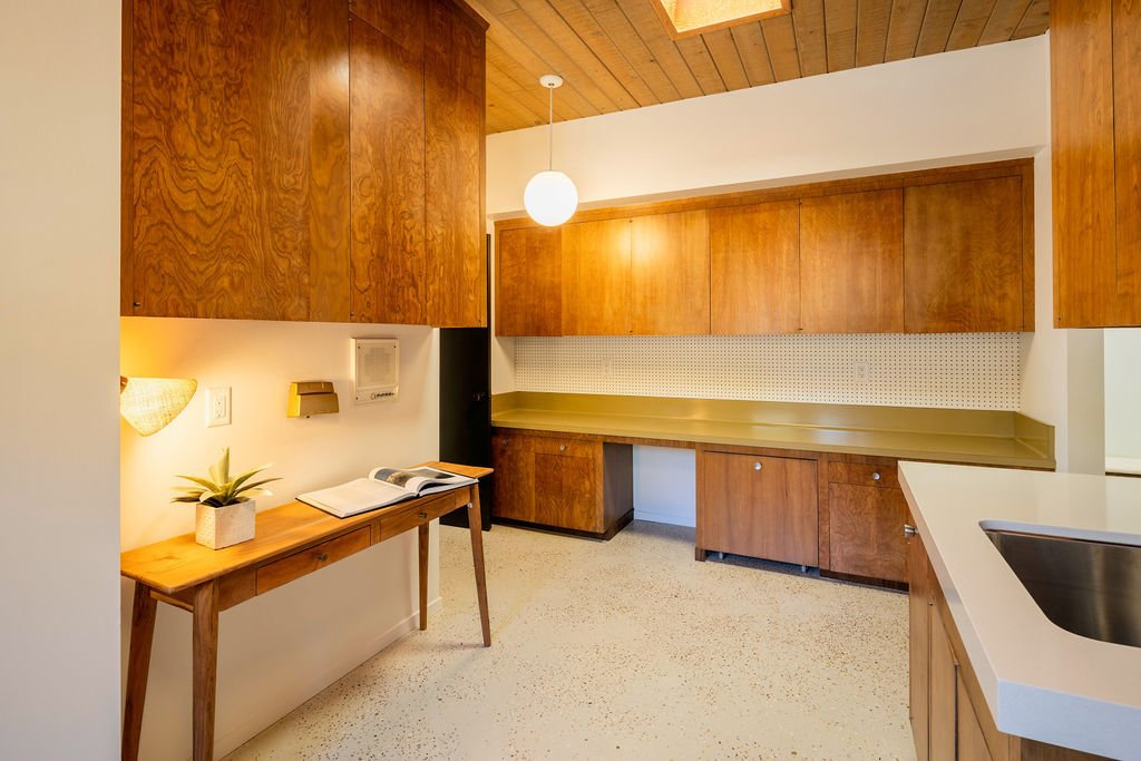 Once Ed's photography studio, a bonus area could become a home office.  Photo 12 of 16 in A Restored Post-and-Beam by a Richard Neutra Protégé Lists for $700K