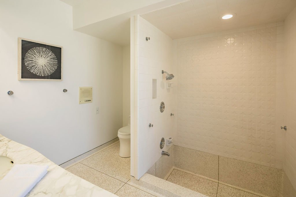 The master bathroom features a terrazzo, Roman-style tub and original marble countertops.  Photo 11 of 16 in A Restored Post-and-Beam by a Richard Neutra Protégé Lists for $700K