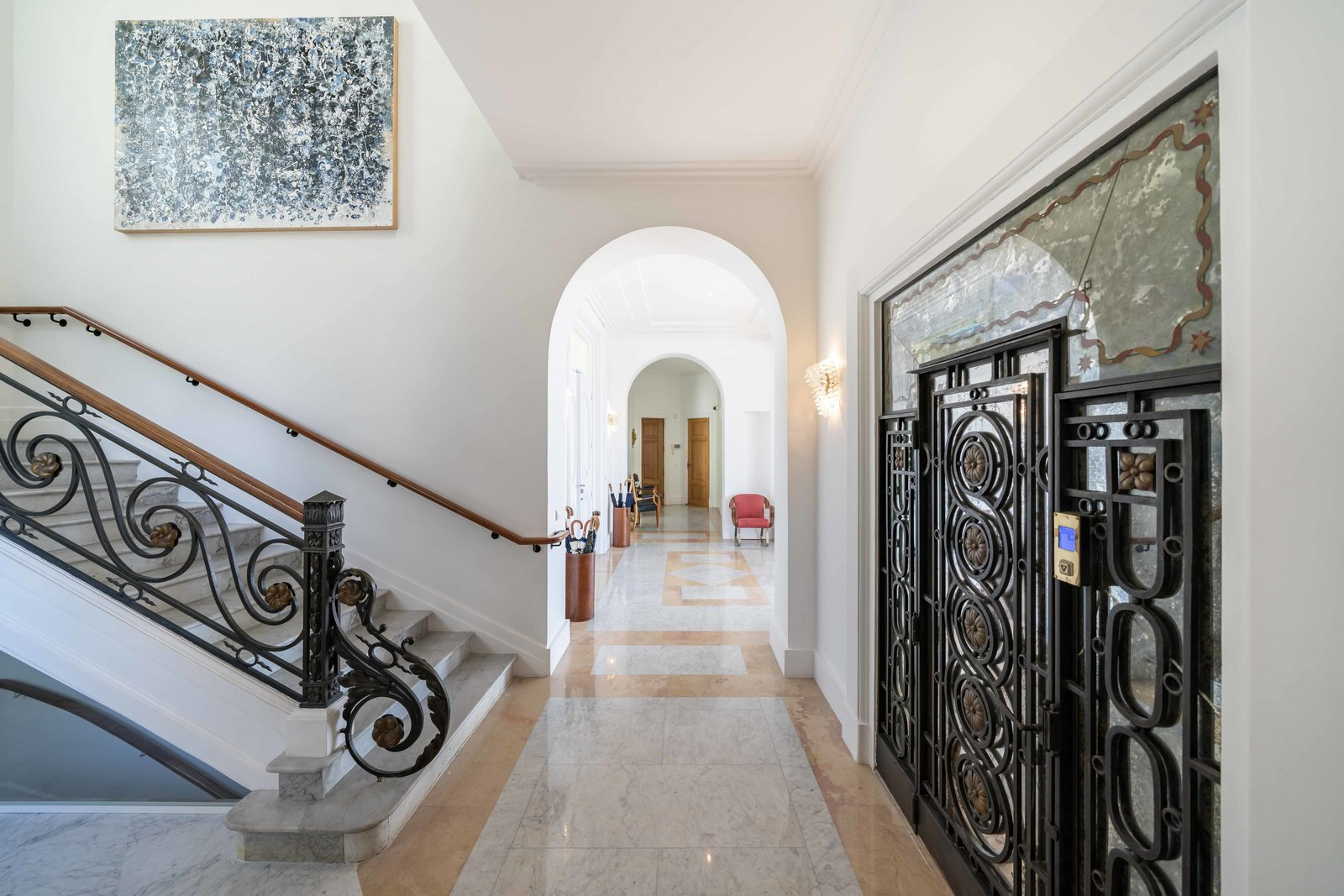 Hallway Spanning 10,700 square feet, the main residence is divided into several floors, all of which are connected by a wrought-iron elevator.  Photo 4 of 11 in Scottish Actor Sean Connery's Former Seaside Villa Looks Like the Perfect Place to Quarantine