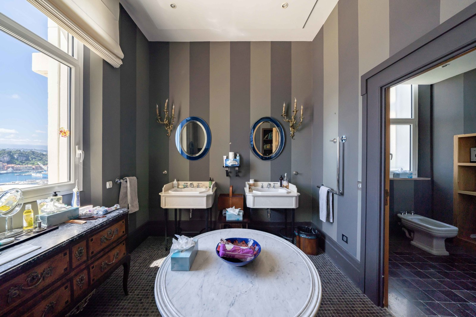 Bath Room, Ceiling Lighting, Wall Lighting, and Pedestal Sink A look into one of the five bathrooms. Large picture windows frame postcard-worthy views.  Photo 6 of 11 in Scottish Actor Sean Connery's Former Seaside Villa Looks Like the Perfect Place to Quarantine