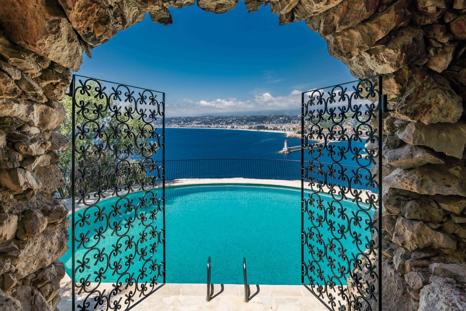 Outdoor, Salt Water Pools, Tubs, Shower, and Large Pools, Tubs, Shower Custom-designed wrought-iron gates open to the saltwater pool, overlooking the nearby sea.  Photo 8 of 11 in Scottish Actor Sean Connery's Former Seaside Villa Looks Like the Perfect Place to Quarantine