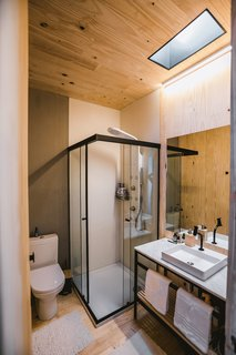 A skylight in the large, fully functional bathroom ushers in natural light.