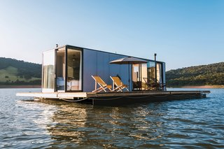 A large deck doubles as a dock for lounging and diving into the surrounding lake.