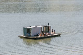 An aerial view of a WaterlilliHaus prefab floating on a lake near Joanópolis, Brazil, about two hours north of São Paulo. SysHaus also offers two smaller versions: the MiniHaus and the NanoHaus.