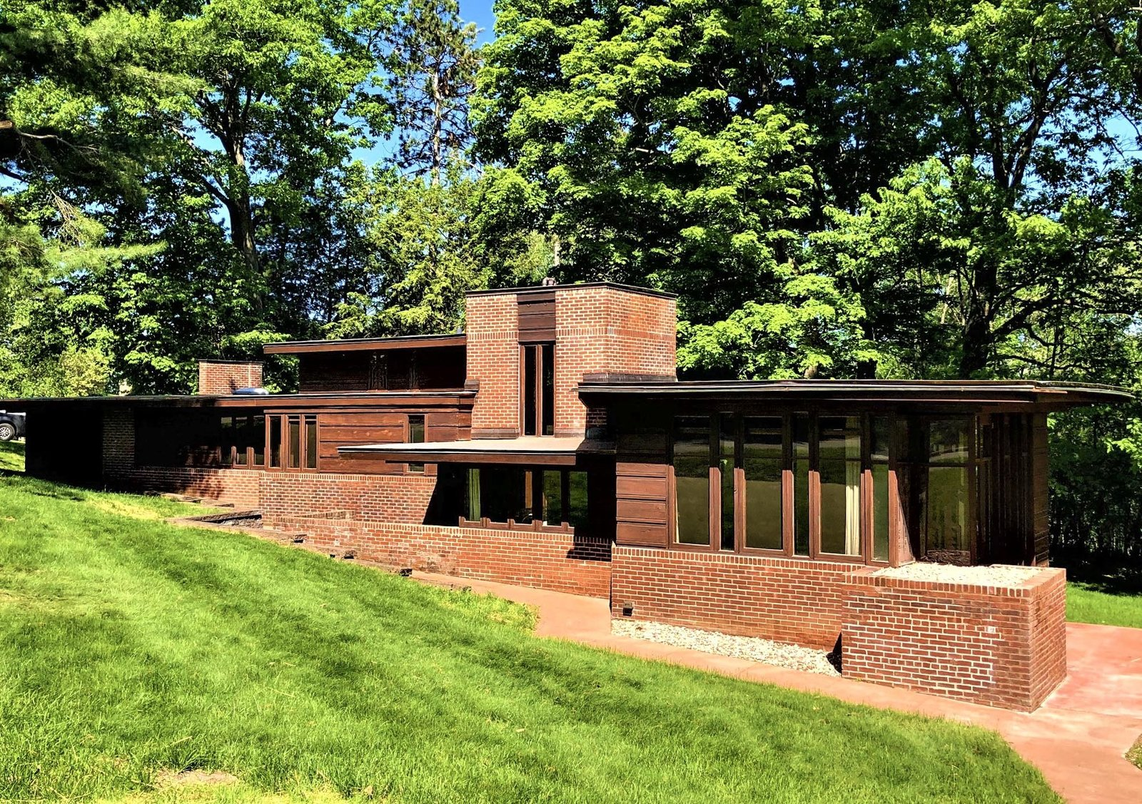 A front view of the home shows the long, horizontal orientation. The home was designed  Photo 10 of 10 in One of Frank Lloyd Wright's First Usonian Houses Hits the Market in Wisconsin for $425K