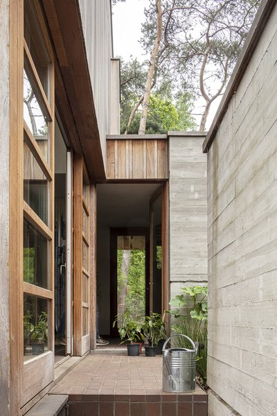 Several doors provide an entrance through the private outdoors space.