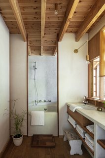 "A look at the bathroom. ""The window also gives a view out to the front garden and lets the morning sun in,"" says David."