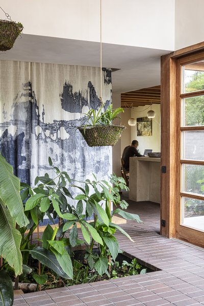 The hanging textile, which is used as a room divider, is by artist Nathalie Van der Massen.