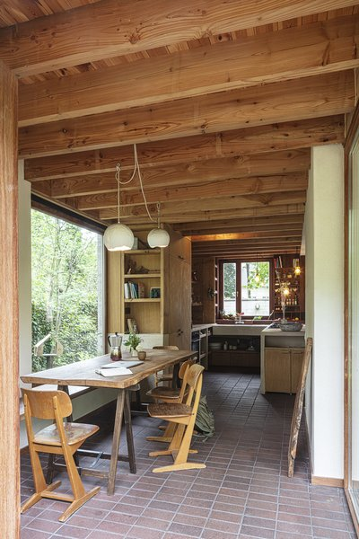 Many of the furnishings were made by the couple from salvaged materials. David designed and built the oak cabinetry in the kitchen, which features a Mortex-coated island.