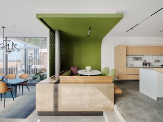 In the kitchen, Fougeron and her team designed a nook backed with sliding panels and lined in green felt from FilzFelt. Solo Wide Dining Chairs by Neri & Hu for De la Espada surround a Dizzie table by Lievore Altherr Molina from Arper.
