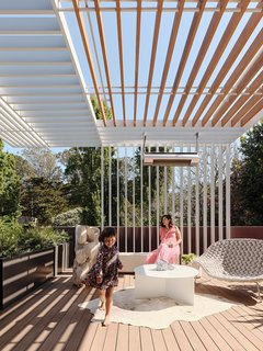 Trellises made of painted aluminum and Alaskan cedar shade a deck off the master bedroom. The Shito chaise longue is from Paola Lenti, the Cluster coffee table by Christian Woo, and the sculpture by Ryosuke Yazaki from The Future Perfect.