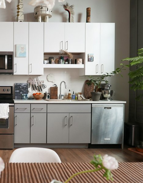 The ceramics on top of the kitchen cabinets are by Judith Salomon.