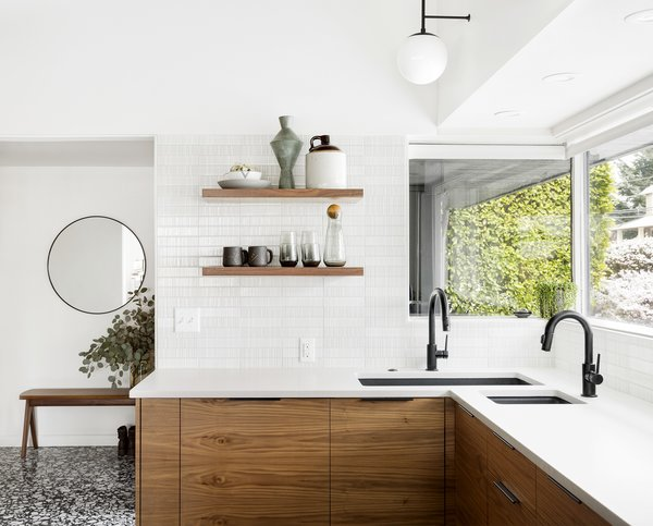 Dyer's renovation of a kitchen in Portland's Burlingame neighborhood opens up walls and reconfigures counter space. The floor is a striking terrazzo from Ann Sack's Renata line.