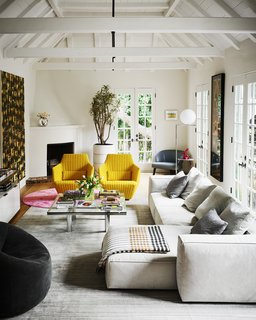 For a home in West Hollywood, Romanek punctuates the living room with a sunny pair of Facett chairs by Ronan and Erwan Bouroullec.