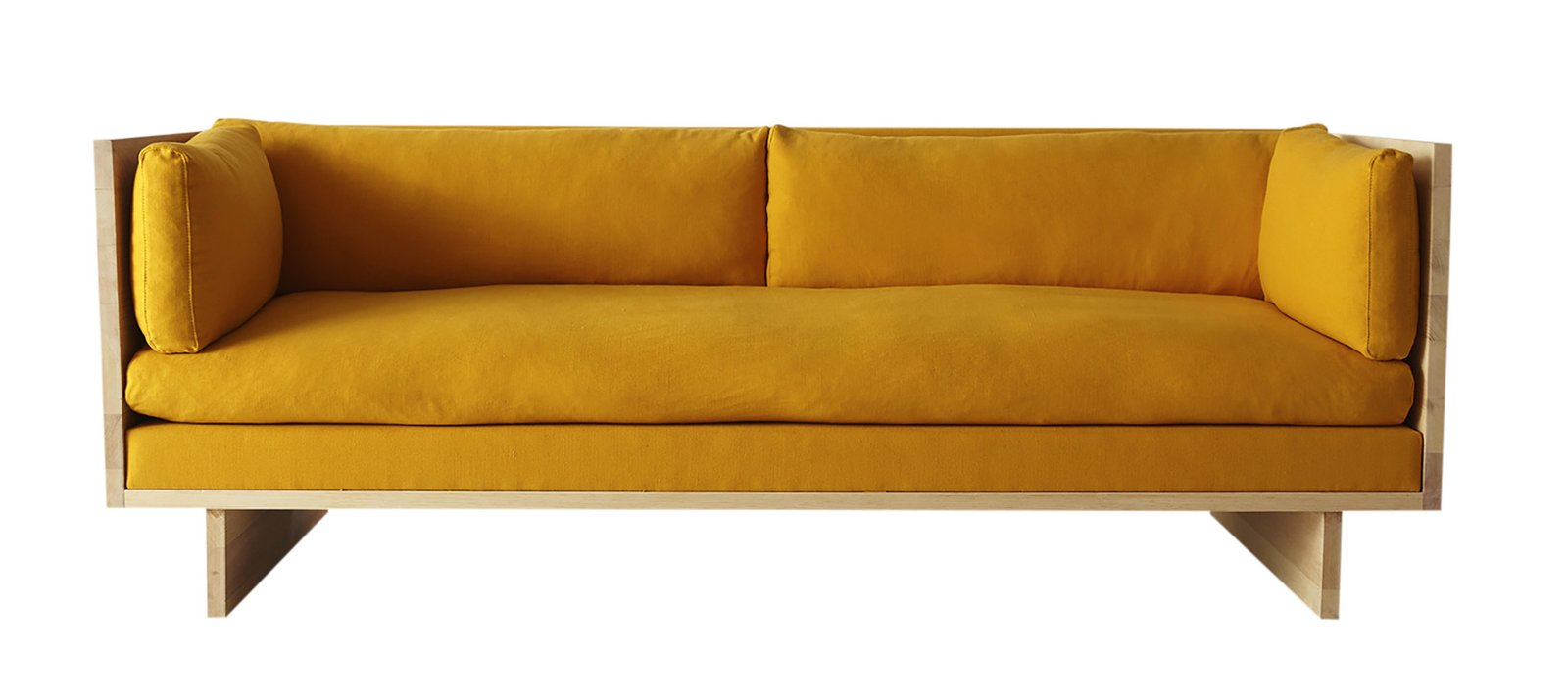 A simple wood frame and easygoing cushions make the sofa from Kalon Studios one of our favorite debuts of the past year. You can currently find it in three flavors: Apricot, Egg (shown here), and Oatmeal.  Photo 8 of 8 in Interior Designer Brigette Romanek Teaches Us How to Set the Scene in a Living Room