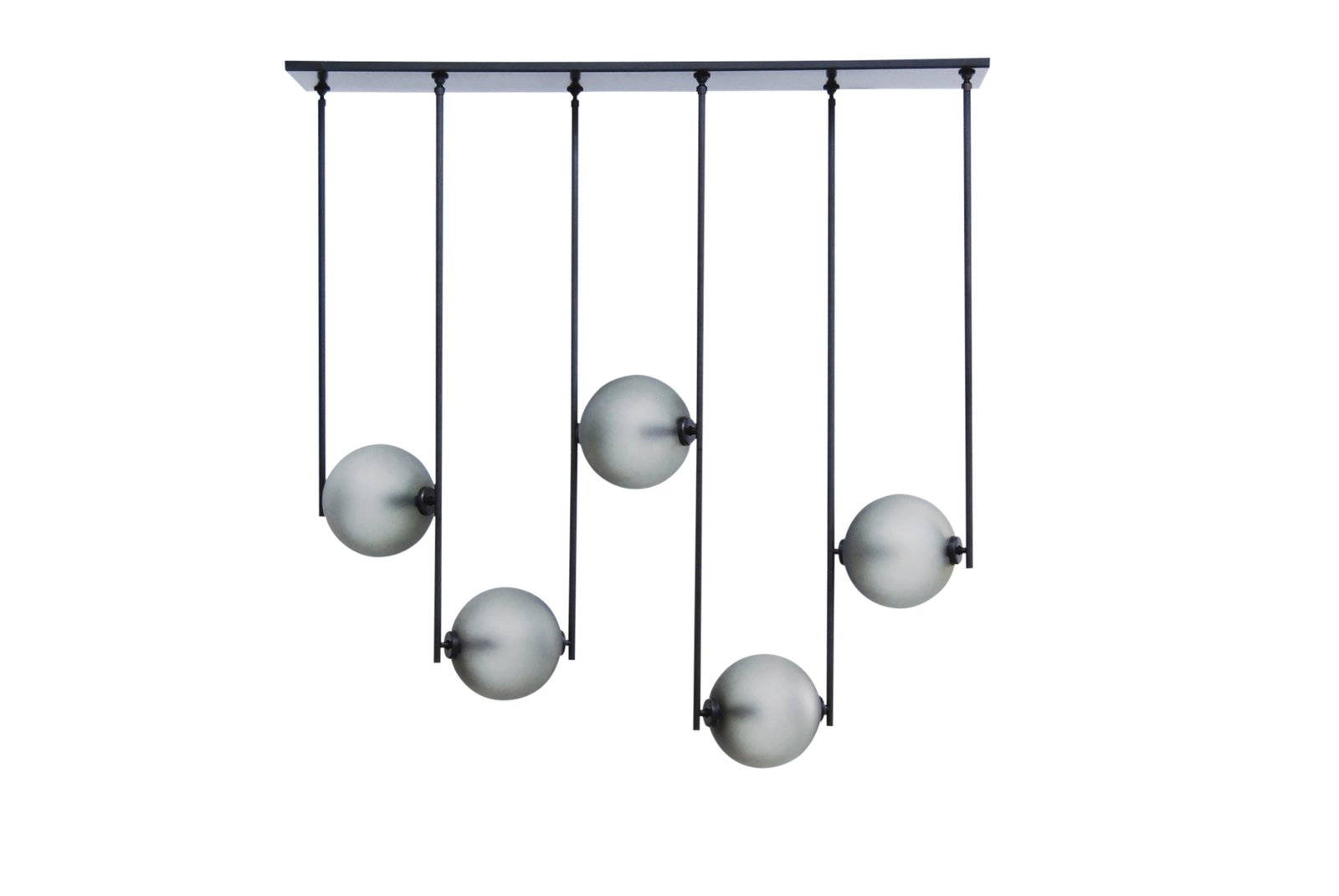 The designers at Ladies & Gentlemen Studio created this fixture as part chandelier and part room divider. Featuring glowing globes suspended between thin metal bars, it comes with a standard set of five elements, but it can be customized.  Photo 5 of 10 in Architects Zoe Chan Eayrs and Merlin Eayrs on Creating a Captivating Dining Area