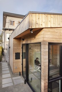 """With his mother moving from Massachusetts to California to be closer to family, architect Peter Liang created a 265-square-foot tiny home, dubbed the Kleines Haus, behind his sister's residence in Oakland for the matriarch to land in. """"Since we are a mixed family, it's key that my kids are close to their grandparents,"""" says homeowner Stefanie Liang Chung. """"Now their German grandmother is teaching them, and I'm grateful that I have an Asian partner who knows that you take in your in-laws."""""""