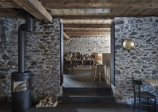 A look at the ground level after the revamp, now home to the Vinothek 1620 wine bar. The fireplace is from Austroflamm.
