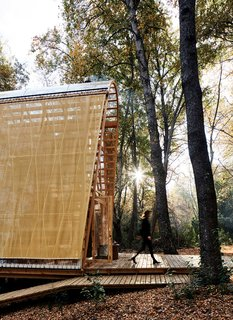 Gloria Montalvo's weekend getaway on a reserve in central Chile is just 580 square feet, but the entire forest is its living room. Designed by architect Guillermo Acuña, it features a transparent facade over a skeletal pine frame.
