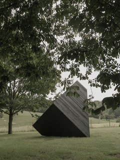 The cabin rests on the grounds of the New Art Centre in Salisbury, England, where it joins a multitude of sculptural artworks.