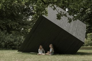 The cabin appears to shift shape when viewed from each new angle.