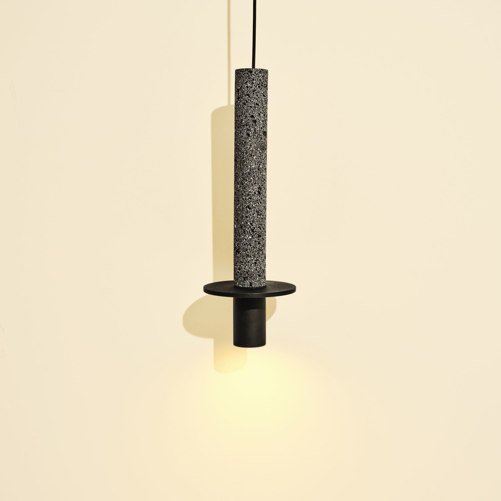 This fixture by Mexico City designer David Pompa contrasts clean lines and polished aluminum with the texture of volcanic rock. In addition to Meta Black (shown), it comes in white and a warm ochre.  Photo 4 of 8 in Interior Designer Stephanie Dyer's Remodeling Tips for the Kitchen