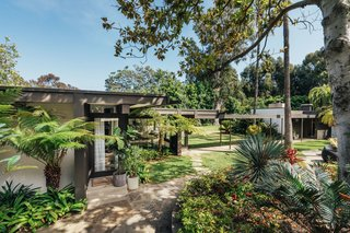 Surrounded by over an acre of lush vegetation, multiple walkways connect the two homes.