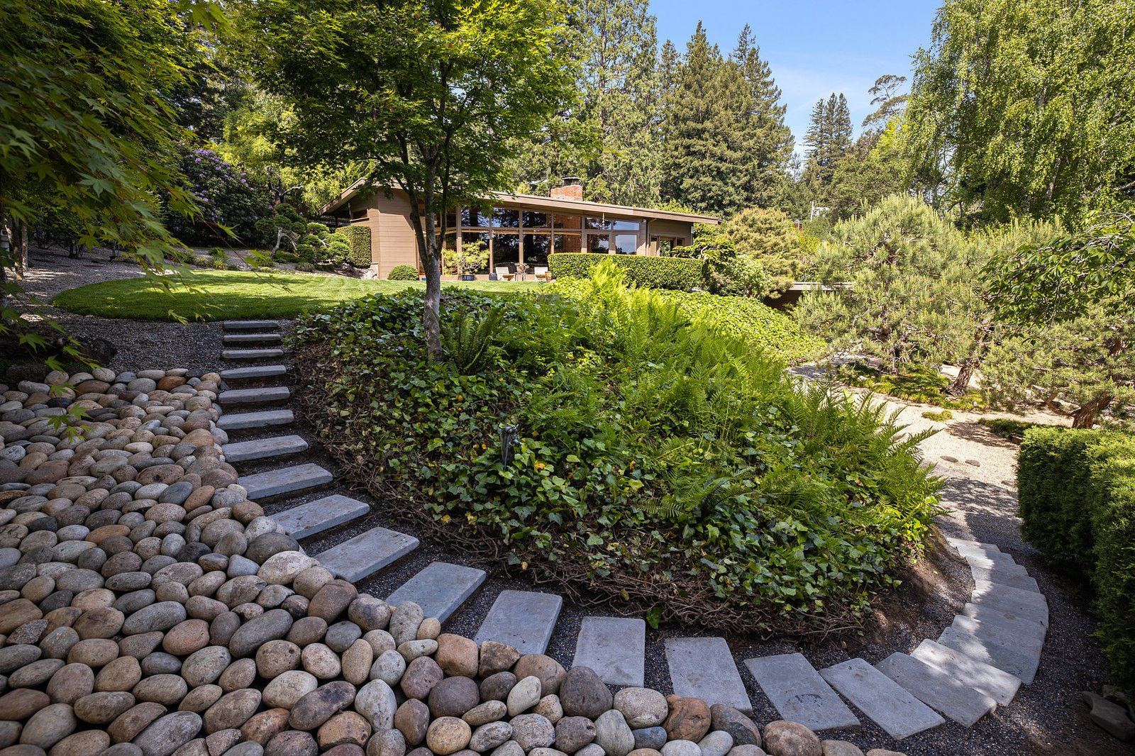 Steps wind down to the guesthouse.  Photo 15 of 21 in An Impeccable Midcentury Compound in the Berkeley Hills Wants $3.4M